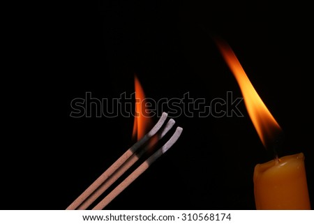 candle , incense sticks - stock photo