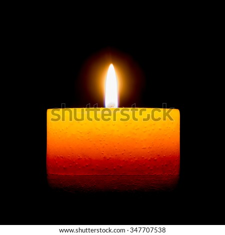Candle isolated on black background - stock photo