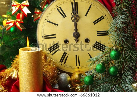 Candle, old clock and Christmas balls