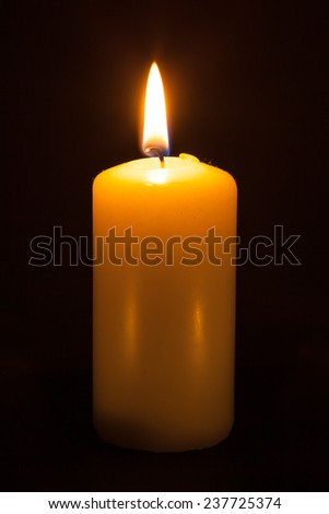 candle on the black background  - stock photo