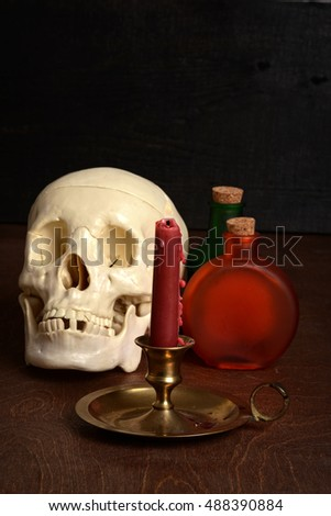 candle with potion bottles and skull