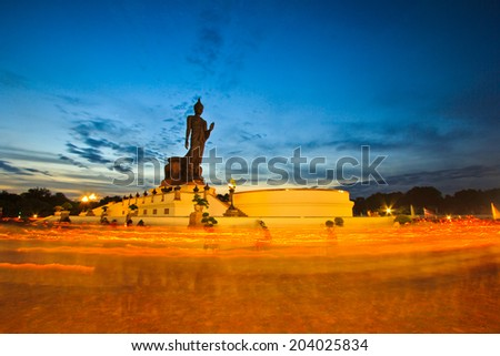 Candlelight Buddha statue candle lit in lent day thailand - stock photo