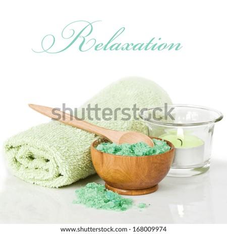 Candlelit bath scene with towel - stock photo