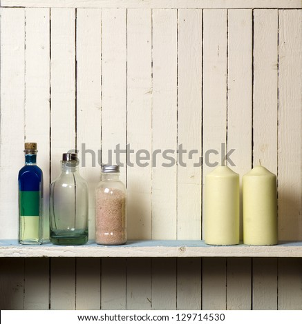 Candles against rustic bathroom wall; good copy space - stock photo