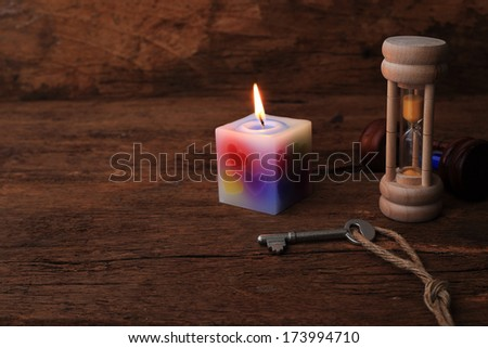 Candles and antique keys on the old wood.