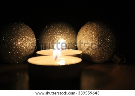 Candles and Christmas balls.