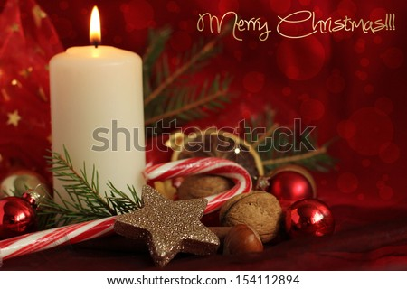 candles and christmas decorations. - stock photo
