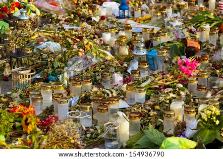Candles and flowers in cemetery - abstract background - stock photo