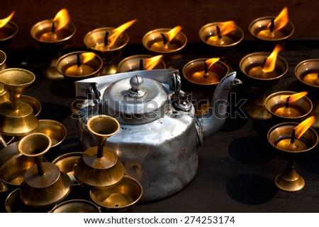 Candles and metal pot at Boudhanath stupa in Kathmandu, Nepal - stock photo