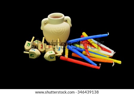 Candles are the symbol of the miracle happened on Hanukkah the Jewish holiday. Oil pot, dreidel and golden coins are another symbol of the holiday. - stock photo