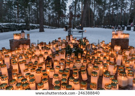Candles in a cemetery in Finland during Christmas - stock photo