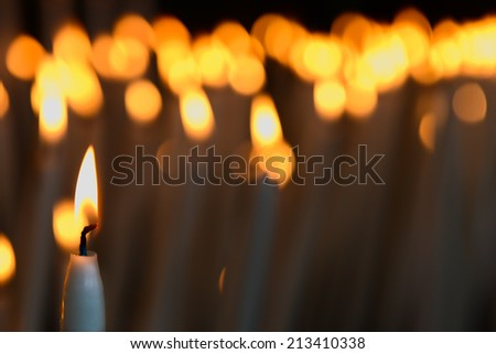 Candles in a church in Lourdes - stock photo