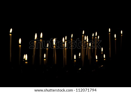Candles in a dark room, giving the impression to float - stock photo