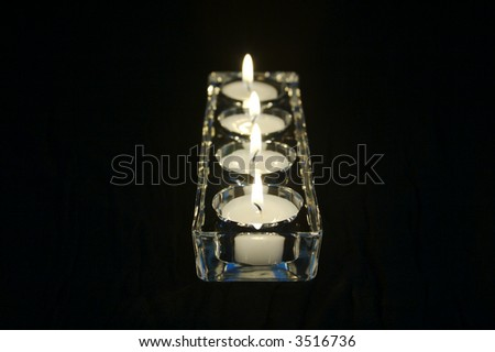 Candles In A Row in Glass