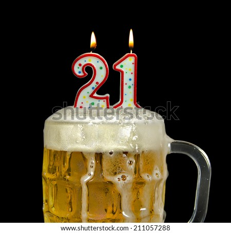 candles in mug of beer for 21st birthday - stock photo