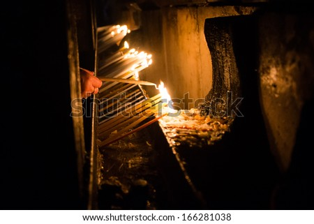 Candles in the Church of the Nativity, Jerusalem, Israel - stock photo