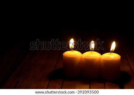 Candles in the dark. conceptual