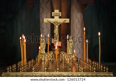 candles in the darkness against the Orthodox cross - stock photo
