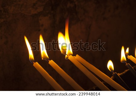 Candles in the Holy Sepulchre in the Jerusalem old city, Israe - stock photo