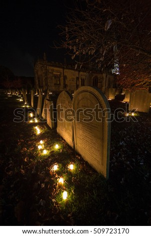 Candles in the old cemetery at at the St. Peter's Parish Church in Hope, England lit on the 1st of November 2016, All Saints Day.