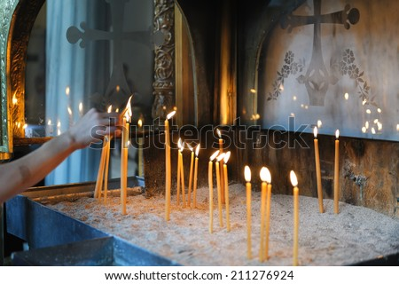 Candles in the Ortodox Church, shallow depth of field, Greece - stock photo