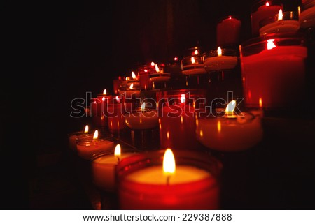 candles inviting for prayer - stock photo