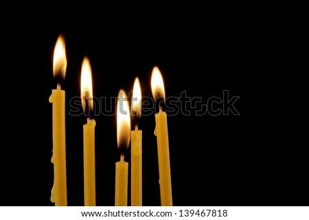 Candles isolated on black background - stock photo