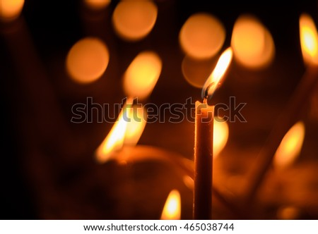 Candles Lighting a Church