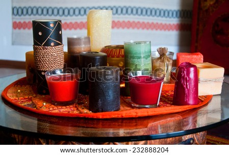 Candles of different shape and color on a table