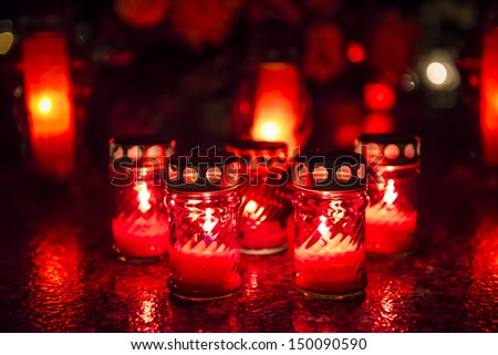 Candles on a grave at night
