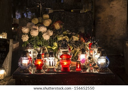 Candles on a grave at night - stock photo