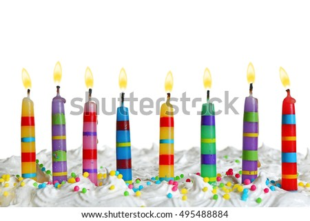 Candles on birthday cake, isolated on white