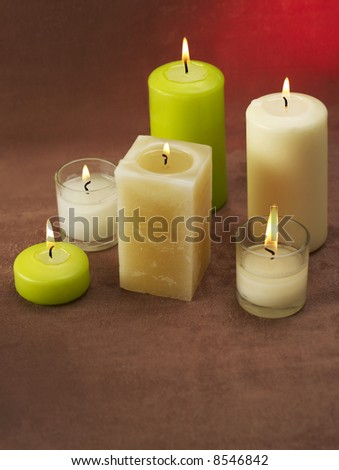 Candles on brown background