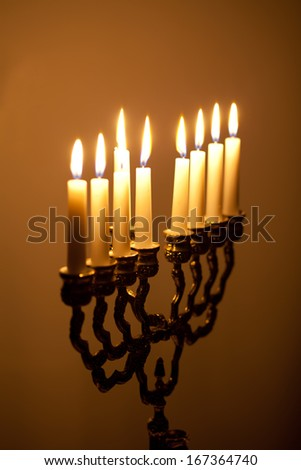 candles on hanukkah menorah - stock photo