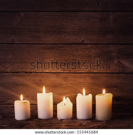 candles on old wooden background - stock photo