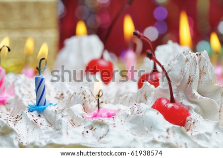 Candles on the birthday cake. Narrow depth of field. Close-up.