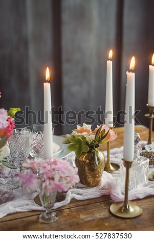 Candles on the table with decor. Wedding decoration. Close-up.