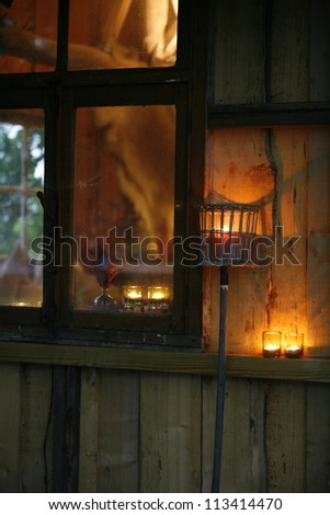 Candles on the wall in a country house