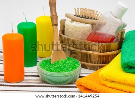 Candles, sea salt, shower gel with towels and other bathroom accessories