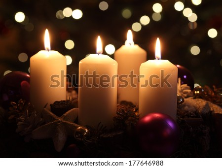 Candles with christmas decoration - stock photo