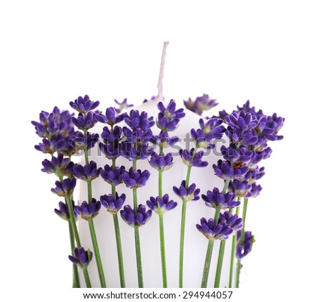 Candles with lavender flowers isolated on white