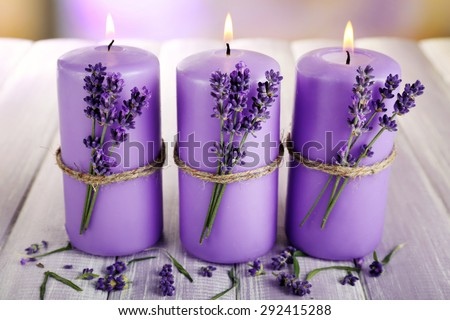 Candles with lavender flowers on table close up - stock photo