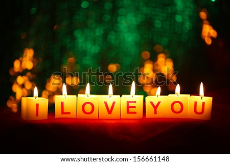 Candles with printed sign I LOVE YOU,on  blur lights background - stock photo