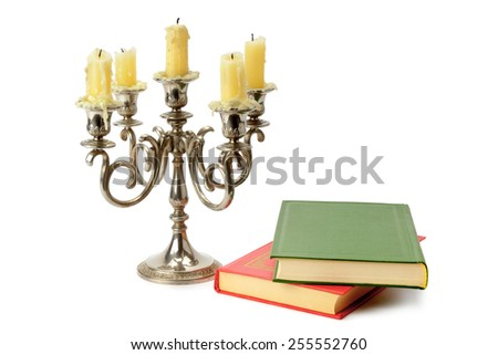 candlestick and books isolated on white background - stock photo