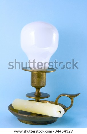 Candlestick, bulb, candle - stock photo
