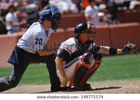 CANDLESTICK PARK, SAN FRANCISCO, CA - CIRCA 1980's: Baseball catcher and umpire at game in Candlestick Park, San Francisco, CA - stock photo