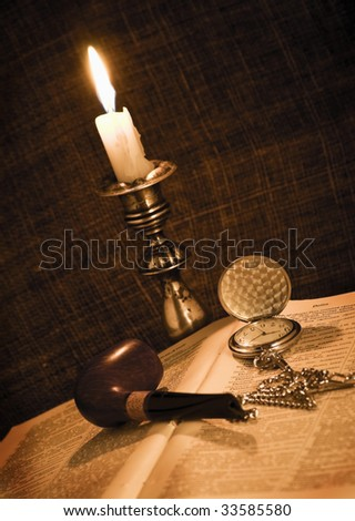 candlestick, pipe and pocket watch
