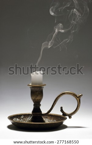 Candlestick with candle. Studio isolated - stock photo