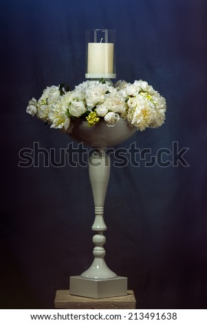 candlestick with candle with flowers - stock photo