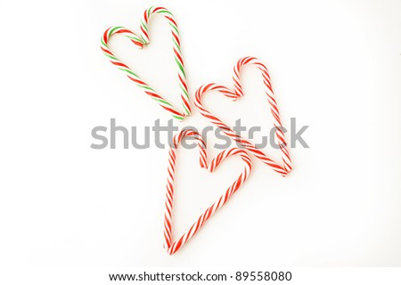 candy canes forming  heart  on a white background